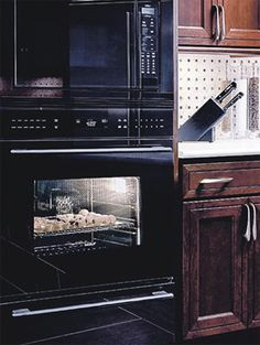 (Wolf Appliance's E Series black glassy oven. Photo courtesy of Wolf Appliance)    Is it over for stainless??