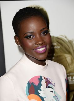 Lupita Nyong'o posing for the cameras at the12 Years A SlaveLos Angeles Premiere.