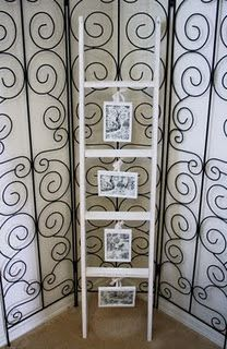 My next project...using the boys' old bunk bed ladder as a photo display.