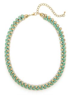 Get twisted — in the most posh and pretty way — with this charming statement necklace. It features gem after gem after gem, in pale pastel colors, all coolly twisted into one glam strand.