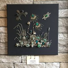 Take an imaginary walk through this amazing garden and admire its abundant delicate metal vegetation! This beautiful garden scene is full of details , materials, shapes and colors. Glass, stone, plastic and metal pieces were used in the making of this amazing piece. This art work