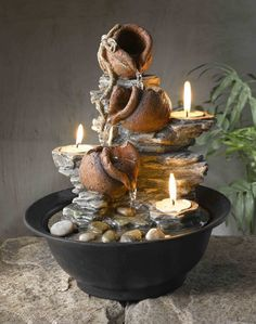 Tavolo Luci Mini Pot Tabletop Fountain with Candle Enjoy the soothing sounds of nature in miniature, with this handsome mini pot table fountain. With three built-in removable tealight candles that giv Indoor Tabletop Fountains, Indoor Water Fountains, Indoor Fountain, Garden Fountains, Outdoor Fountains, Indoor Waterfall, Waterfall Fountain, Mini Waterfall, Tea Light Candles