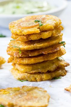 Paleo tostones {twice fried plantains) cooked in coconut oil and served with a Whole30 compliant avocado ranch dip. Crispy, savory and delicious!