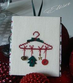 Cute idea for all those Christmas buttons I have