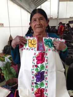 Gorgeous cotton blouse hand embroidered by this indigenous artisan of Cocucho, Michoacán.