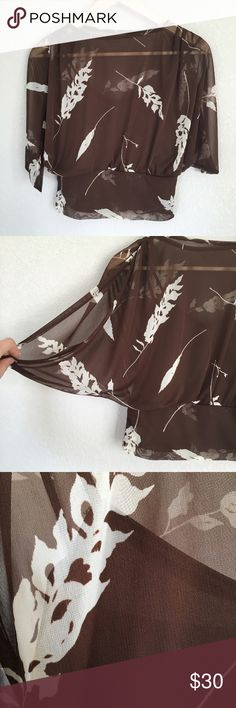 """Cami Bell Sleeve Floral Brown Top Excellent condition, retro-style top: brown cami sewn into a sheer brown floral overlay. Bell-type sleeves have open slits on the arms. 100% polyester, hand wash cold, hang dry. Measures 13"""" flat across bottom waist band. Made in USA. Flat measurements: 13"""" across bottom (has elastic for stretch up to 18""""); sleeve length 17""""; boat neck opening 9"""" across; length 19.5"""". Hot Sauce Tops"""