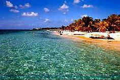 The crystal clear Caribbean waters off the coast of Roatan are ideal for swimming, snorkeling, diving, and kayaking.