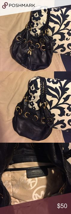 🎀 Michael Kors Black Leather Purse This will be your Favorite Michael Kors Leather Black Bag. Braided Handle. Fabulous Gold Accents!!! Cute Leather Tassles. Beige interior with MK emblem. Interior side compartments. Medium Size. Good, Pre-loved Condition ❣️                                                 🔶Reasonable Offers Welcomed🔶                      🔷Bundle To Save🔷 Michael Kors Bags Shoulder Bags