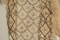 Dress.  House of Worth (French, 1858–1956).  Date: 1913. Culture: French. Medium: silk, glass, metal. Dimensions: Length: 76 3/8 in. (194 cm).