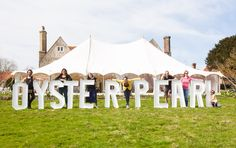 The team in front of the stunning Oyster Pearl tent!