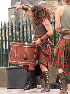 Albannach - drumming in Scottish plaid kilt ceremony. Love the ace up boots and flowing long hair that shows drumwork action! Scottish Music, Scottish Man, Scottish Dress, Motif Music, Tweed, Highland Games, Celtic Music, Tartan Kilt, Men In Kilts