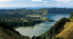 A World Apart - Azores, Portugal - By Andrew McCarthy, Islands Magazine March 2010 | Close yet distant. Accessible but isolated. The Azores may brim with beauty, but they remain... | I'm on the rim of a Volcano—fifteen hundred feet below, inside the caldera, two lakes shimmer beside a whitewashed village. This is Sete Cidades, the most popular postcard shot in the Azores. Yet I take in the vista alone - a solitary hawk circles overhead.