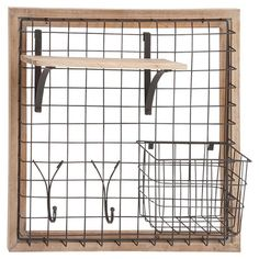 An essential addition to your kitchen or entryway, this industrial-chic wall rack features 1 shelf, 2 hooks, and a wire basket.  Pro...