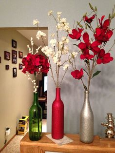 Single branch pieces in simple reused wine bottles! Wine Bottle Vases, Wine Bottle Crafts, Bottle Candles, Silver Christmas Decorations, Diy Wedding Decorations, Simple Christmas, Christmas Crafts, Christmas Tree, Christmas Wine Bottles