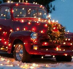 red truck with lights and Christmas wreath
