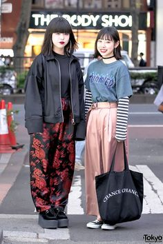 "Nanase and Luna are 17-year-old Japanese high school students – both wearing a mix of vintage and new items – who we met on the street in Harajuku. Nanase – on the left – is wearing a ""No Future"" jacket from the vintage shop Faith Tokyo over a black shirt, Asian dragon print satin pants from Faith, and tall platform creepers from Nadia Harajuku. Accessories include hoop earrings and a leather sackpack from the Japanese streetwear brand MYOB NYC. Nanase's favorite shop is Faith Tokyo. She…"