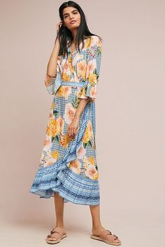 All-over florals and bell sleeves give a modern feel to this classically bohemian silhouette.