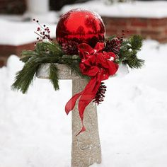 PUT THIS ON THE FOUNTAIN STAND Fresh greenery, a large red ball, red-painted pinecones and a bright bow look festive in this wintry scene. Just one of easy decorating ideas! Noel Christmas, Country Christmas, Winter Christmas, All Things Christmas, Christmas Wreaths, Xmas, Christmas Ideas, Scandinavian Christmas, Holiday Crafts