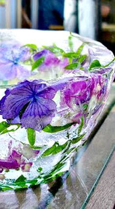 Floral Bowl made of Ice - keeps beverages and food chilled in style. Please remember to set out on a tray to catch the melting ice.