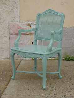 A French style armchair, non-distressed, in Sweet-Pea Green.   This color is similar to my Victorian Moss color, but the amber hue of the moss color is toned down, giving it a more silvery-pale appearance.  Customer requested no distressing.  Original caned back was painted over.