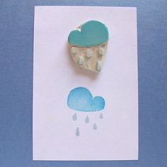 Hand-carved cloud and raindrops stamp