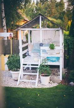 Make an adorable garden playhouse or she shed in your backyard with this easy outdoor DIY project. #gardenplayhouse #buildplayhouseeasy #buildplayhouses #backyardshed #outdoorplayhousediy