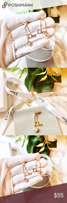 Beautiful Dior initials gold logo earring This is a pair of beautiful, classic, iconic and delicate earring feature Dior initials and large clear crystal , in gold tone metal with very fine detailing . No designer hall mark but tested to be authentic and Brand new. Vintage style Christian Dior Jewelry Earrings