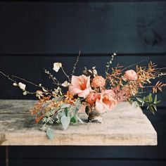 A winter centerpiece with peach amaryllis, garden roses, ranunculi, gold- and wine-colored orchids, and an unruly assortment of foraged goods | Joy Thigpen
