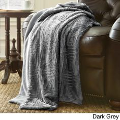 Beautiful luxury faux fur throw adds dimension and style to this captivating single-color throw blanket. Crafted with soft microfiber polyester faux fur, this charming throw comes in several chic color options and is conveniently machine washable.