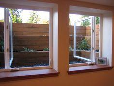 Bit modern, but nice idea to have tiered garden egress window