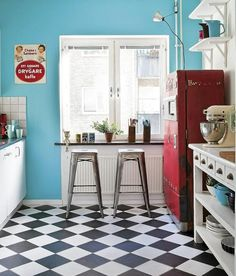 Love the damn floor. Love it. Paired with the blue walls and the seriously cool red fridge. There's so much about it I love.