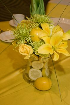 Fruit and Floral centerpieces are all the rage...Bright yellow!