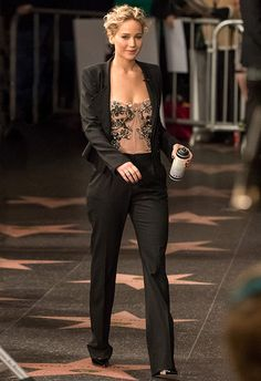 Just when you thought the corset was out for good, J-Law made it chic x100 by pairing an embellished, raw-edge beauty with a simple-but-sharp black suit. Finish with black pointed heels, an understated updo and you've got the perf drinks get-up