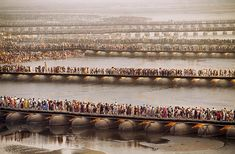 Crowds gather for the Kumbh Mela festival on temporary pontoon bridges across the River Ganges - Steve McCurry from the book India