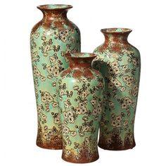 Conjunto de jarrones de cerámica para decorar tu hogar, quedarán fantásticos en tu comedor o salón. Fabricado en cerámica color marrón con flores turquesa.      Medidas disponibles:         18 x 18 x 38.5 cm         19.5 x 19.5 x 45.5 cm         20 x 20 x 54 cm