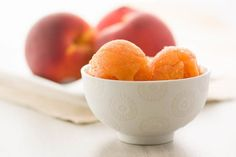 A simple recipe for homemade peach sorbet. Fresh, organic peaches from Stemilt in Washington State with simple syrup and a burst of lemon makes this a sweet summer treat. Peach Sorbet, Thermomix Desserts, Snack Recipes, Snacks, Vegan Ice Cream, Summer Treats, Simple Syrup, Summer Recipes, Easy Meals