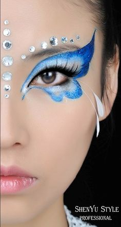 Butterfly inspired eye make-up with crystal accents and subtle feather lashes.