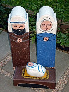 Outdoor nativity set - acrylic paint applied to garden edgestones, brick paver and a rock