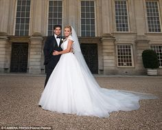 The bride and groom: Katherine Jenkins looks sensational in her wedding gown after tying the knot with Andrew Levitas at Hampton Court Palace on Saturday Celebrity Wedding Dresses, Modest Wedding Dresses, Celebrity Weddings, Making A Wedding Dress, Gorgeous Wedding Dress, Bridal Gowns, Wedding Gowns, Katherine Jenkins, Star Wedding