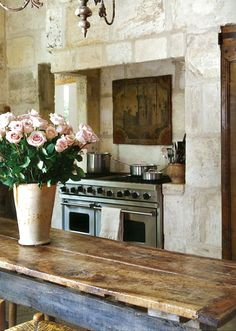From Betty Lou Phillips' book The French Way with Design comes this beautiful kitchen with walls of French Bugets.