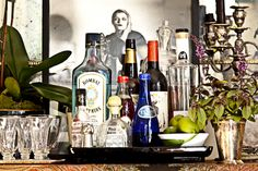 basically what our household bar looks like plus maybe a few other things. Home Bar Sets, Bar Set Up, Mini Bars, Mini Bar At Home, Bars For Home, Bandeja Bar, Bar Cart Styling, Tray Styling, Bar Tray