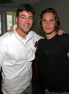 Kyle Chandler and Taylor Kitsch... i hate that this show is not on anymore, it was so good.. Friday Night Lights