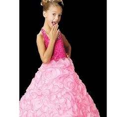 Your little girl will look gorgeous in this hot pink pageant dress by Sugar! This is the perfect gown for a national or local level pageant. The beautiful organza cupcake skirt is ruffled to perfection with tone on tone trim and bead after bead of detail and rhinestones.
