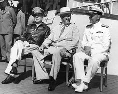 General MacArthur, President Roosevelt, and Admiral Nimitz aboard USS Baltimore, Pearl Harbor, US Territory of Hawaii, 26 Jul 1944.