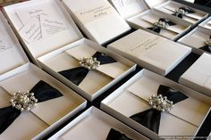 Black and white elegant wedding invitations in a mailing box with guest information cards in the lid of the box