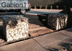 Gabion entrance.  Low Cost gabions Cheaper than block stone gabion walls are easy to build  http://www.gabion1.com.au