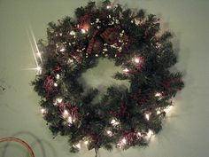 Add a Christmas wreath with jingle bells and pip berries to add color and fun to your decor! We offer many Christmas items at Primitive Star Quilt Shop. https://www.primitivestarquiltshop.com/collections/wreaths/products/primitive-christmas-wreath-jingle-bells-and-burgundy-pip-berries #primitivecountryhomedecor