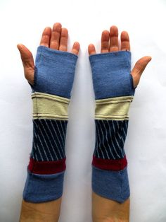 One-of-a-kind segmented arm warmers.    Crafted from recycled super comfortable merino wool sweaters.    Perfect for the tech savvy generation. Allow for texting while staying warm and in high fashion. Great for working in a cold office or outdoors on cool days.    Measure 11.75 inches long.    Sized to fit most teen and adult women. Hand wash cold, reshape and lay flat to dry.