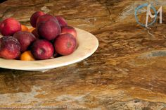 A close up reveals rich custard and honey highlights in the Amarello Bamboo granite.