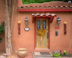 Door and wall at Tularosa NM - by TheBlindHog, via Flickr -